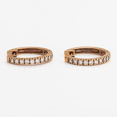 A pair of 14k gold earrings with diamonds ca. 0.60 ct in total.