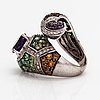 A 14k white gold ring with garnets, citrines, amethysts and diamonds ca. 0.42 ct in total.