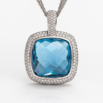 An 18K white gold pendant with a topaz and diamonds ca. 2.70 ct yht.