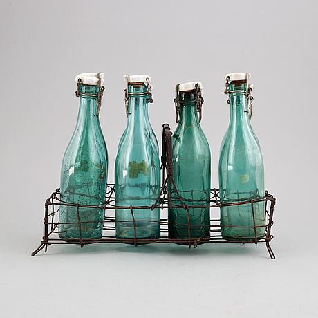 A metal bottle holder, first half of the 20th century.
