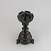 A late 19th century bronze candlestick.