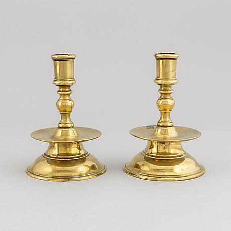 A pair of 19th century bronze candlesticks.