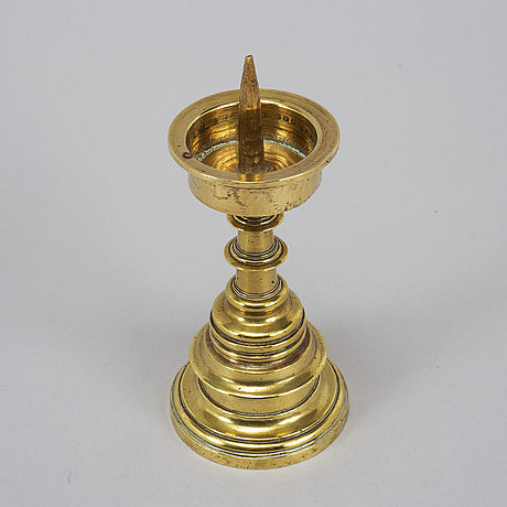 A 16th century bronze candlestick.