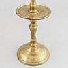 An 18th century bronze candlestick.