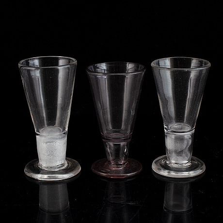 Six similar 18th century wine glasses.