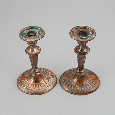 A pair of brass and a pair of plate candlesticks, 19th century.