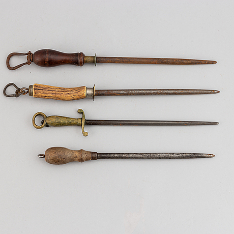 Four iron, wood and bronze knife honers, 18th/19th century.