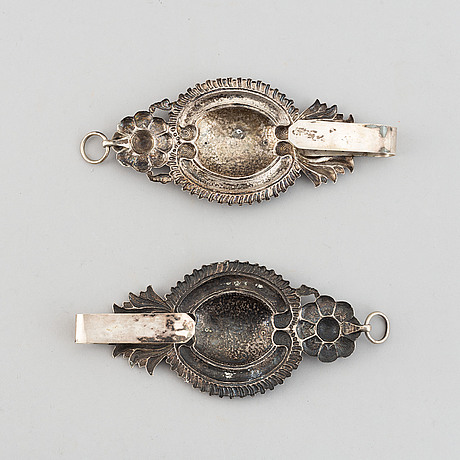 A pair of 19th century silver curtain tie-backs.