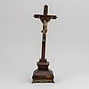 An 18th century stained wood crucifix witn brass inlay.