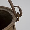 A large 18th century brass cauldron.