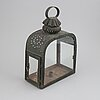 An 18th century tinplate and glass lantern.