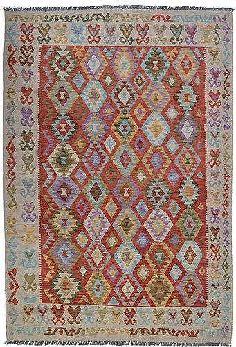 A rug, kilim, ca 290 x 207 cm.