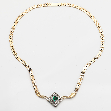 A 14k gold necklace with a ca. 1.20 ct emerald and ca. 2.80 cts of baguette and brilliant cut diamonds. italy.