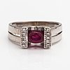 An 18k white gold ring with a ruby and diamonds ca. 0.067 ct in total.