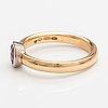 An 18k gold ring with a garnet. a tillander, helsinki 2008.