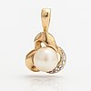 A 14k gold pendant with a cultured pearl and a diamond ca. 0.005 ct.