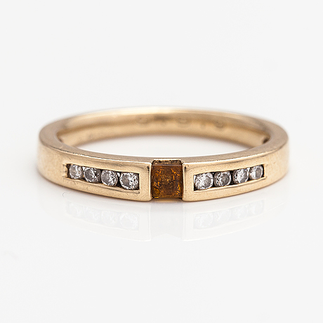 A 14k gold ring with a citrine and diamonds ca. 0.08 ct in total.