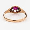 A 14k gold ring with a synthetic ruby.