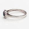 A 14k white gold ring with a sapphire and diamonds ca. 0.07 ct in total. kultajousi 2016.