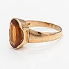 A 14k gold ring with a hessonite garnet.