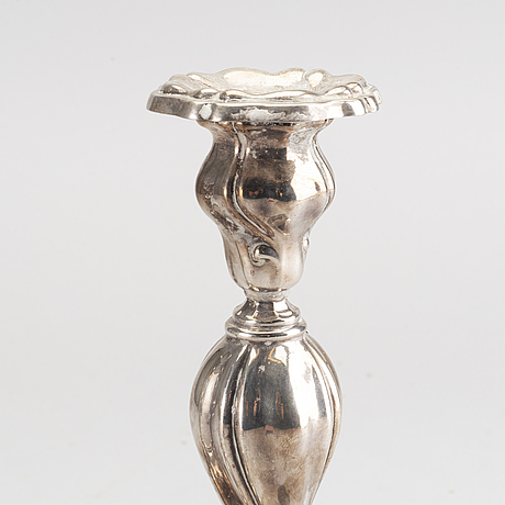 A 20th century pair of silver candle sticks rococo-style, height ca 22 cm.