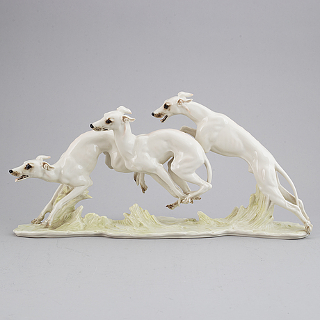 Hans achtziger, a porcelain figurine of dogs, hutschenreuther, germany.