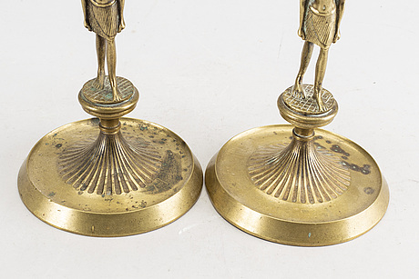 A pair of early 20th century brass candle sticks.