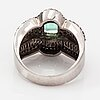 An 18 white gold ring with an emerald and diamonds ca. 1.50 ct in total.