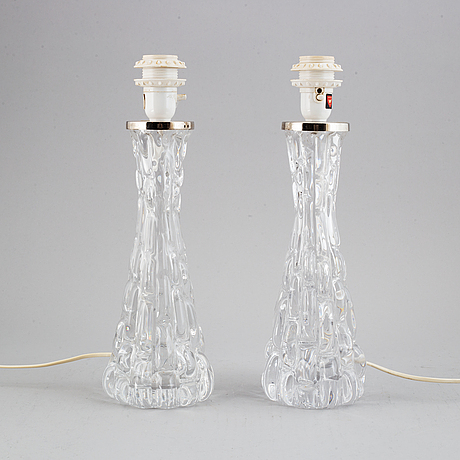 A pair of orrefors table lamps designed by carl fagerlund.