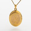 A 14k gold necklace with a locket.