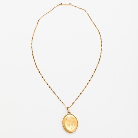 A 14k gold necklace with a medallion.