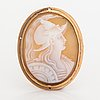 A 14k gold and sea shell cameo brooch.