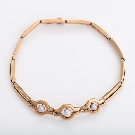 A 14k gold bracelet with cultured pearls.