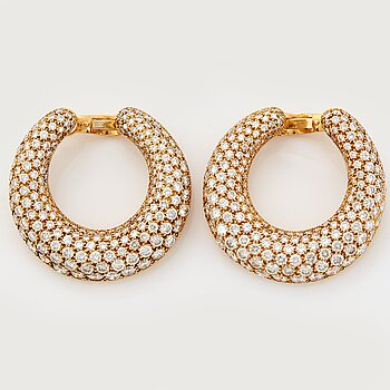 897. Cartier a pair of hoop earrings.