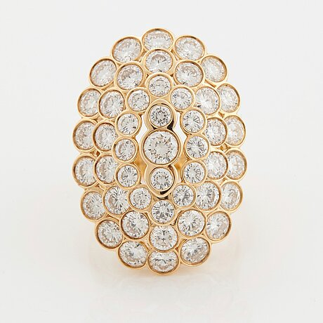 Cartier a ring in 18k gold set with round brilliant-cut diamonds.