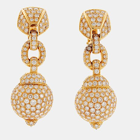 Cartier a pair of earrings in 18k gold set with round brilliant-cut diamonds.