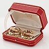 """Cartier """"panthère"""" a pair of 18k gold and enamel earrings."""