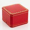 "Cartier ""panthère"" an 18k gold and enamel bracelet set with emeralds."
