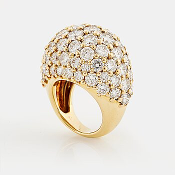 "900. Cartier ""Marrakech"" an 18K gold bombé ring set with round brilliant-cut diamonds."