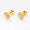 Drop shaped yellow and white brilliant-cut diamond earrings.