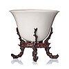 A rhinoserous shaped blanc de chine libation cup, qing dynasty.
