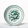 A green glazed five clawed dragon dish, qing dynasty with qianlong mark.