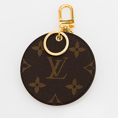 Louis vuitton, a 'monogram reverse' key holder and bag charm.