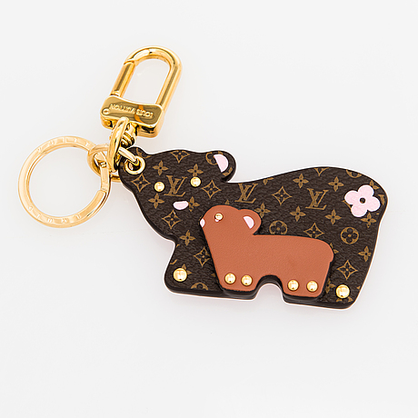 Louis vuitton, a 'mummy and baby bear' bag charm and key holder.