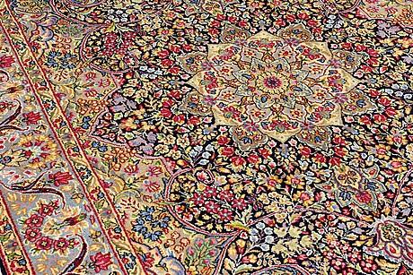 A carpet, kerman, ca 285 x 179 cm.