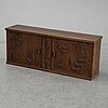 A 20th century wall mounted wood carved relief cabiner.