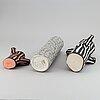 A set of three ceramic vases by hay.