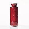"Wilhelm kåge, a red glazed ""argenta"" stoneware vase, gustavsberg, sweden 1950's."
