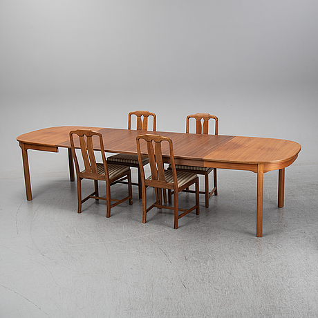 Carl malmsten, a five-piece walnut 'ambassadör' dining suite by carl malmsten.