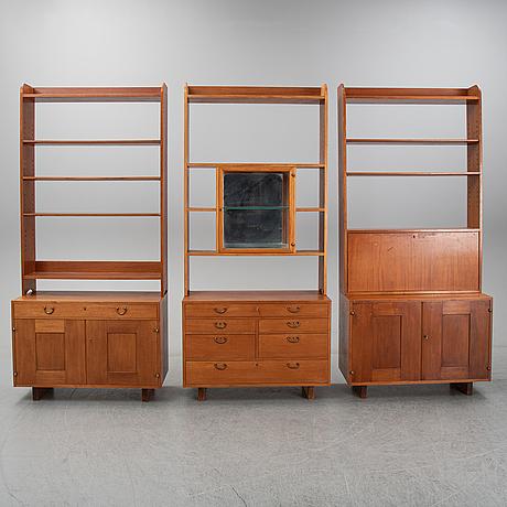 Josef frank, a set of three mahogany bookcases, model 2112, firma svenskt tenn.